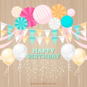 Decorazione di compleanno bella con palloncini e bandierine