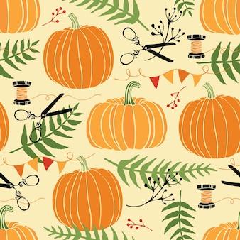 Decorazioni festive, zucche e felci