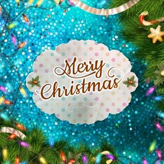 Decorazioni natalizie con coriandoli blu sullo sfondo.