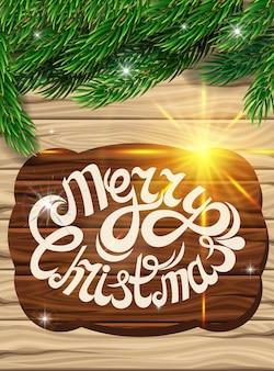 Decorazioni natalizie sullo sfondo delle assi di legno.