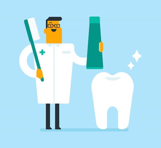 Dentista che tiene dentifricio e uno spazzolino da denti.