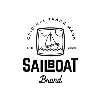 Design del logo classico del marchio della barca a vela