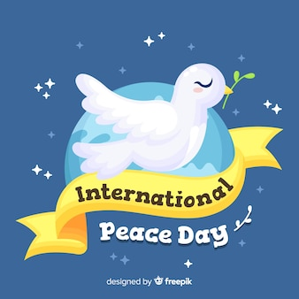 Design piatto giornata di pace con una colomba