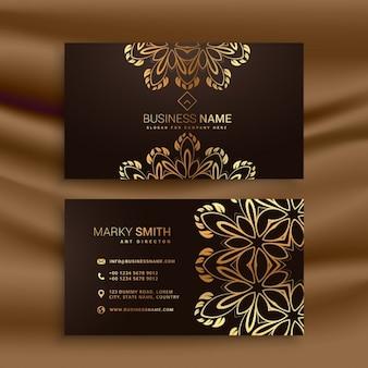 Design premium biglietto da visita di lusso con decorazione floreale dorata