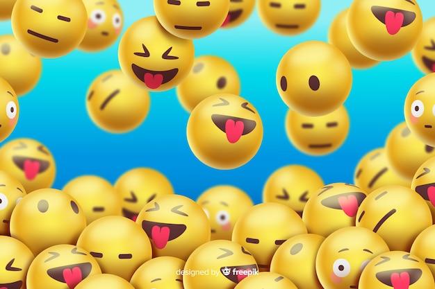 Design realistico di sfondo emoji galleggiante
