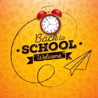 Di nuovo a scuola con la sveglia rossa e la lettera di tipografia su giallo