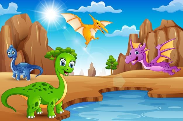 Dinosauri felici dei cartoni animati che vivono nel deserto