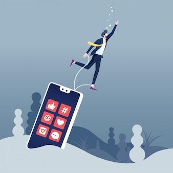 Dipendenza da social media annegamento dell'uomo d'affari incatenato con lo smartphone