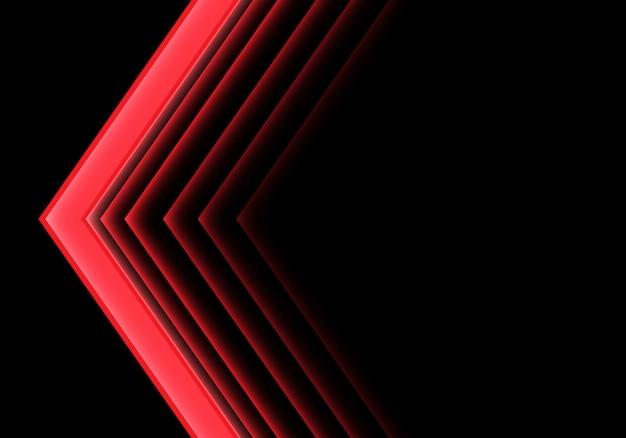 Direzione al neon della luce rossa della freccia su fondo nero.