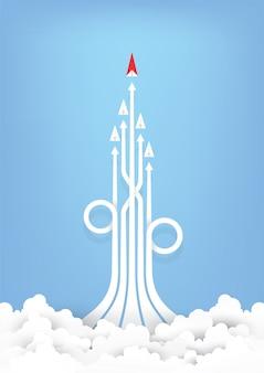Direzione dell'aereo di carta rossa di origami su cielo blu
