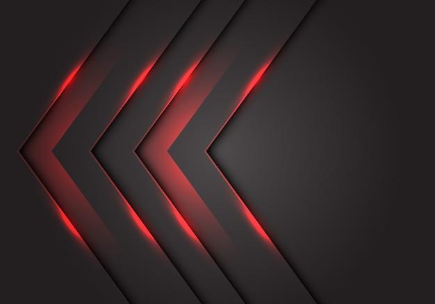 Direzione della freccia 3d della luce rossa, fondo grigio scuro dello spazio.