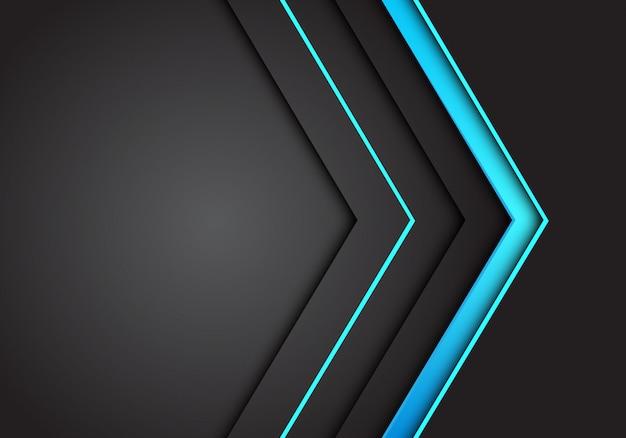 Direzione della freccia al neon della luce blu su sfondo grigio scuro.