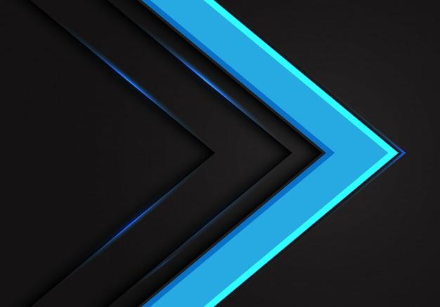 Direzione della freccia blu su sfondo scuro spazio vuoto.