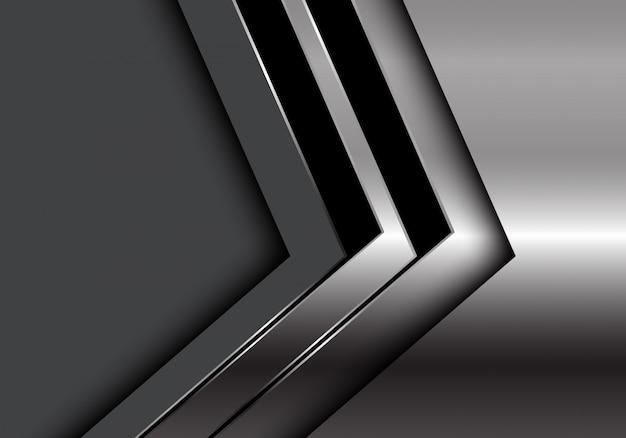 Direzione della freccia nera d'argento sfondo grigio scuro.