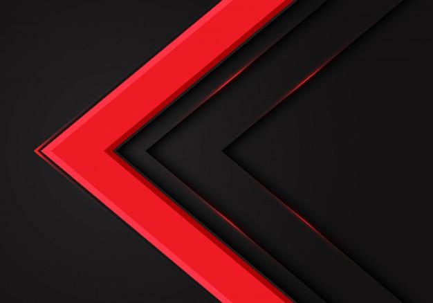 Direzione della freccia rossa su sfondo scuro spazio vuoto.