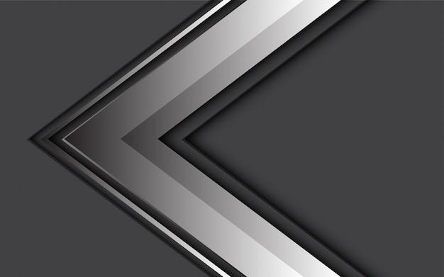 Direzione grigia astratta della freccia su designchallenge scuro