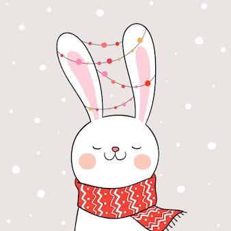 Disegna il coniglio sulla neve per natale e capodanno.