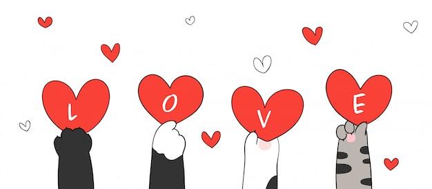 Disegna le zampe di gatto che tengono il cuore rosso e la parola amore per la cartolina d'auguri di san valentino