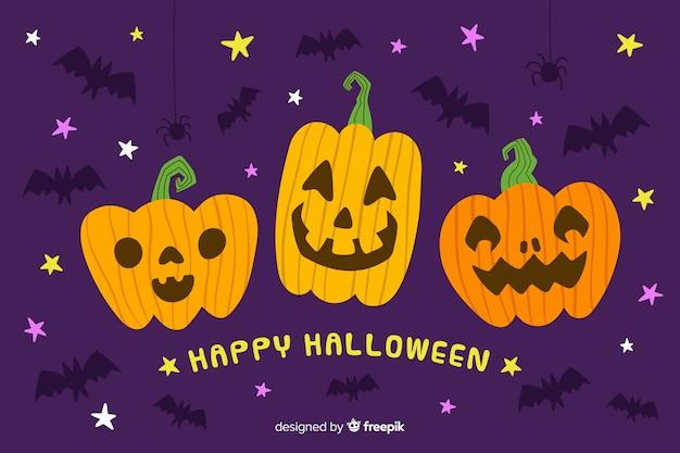 Disegnata a mano sfondo di halloween con zucche