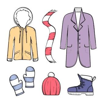 Disegnati a mano abiti invernali ed elementi essenziali