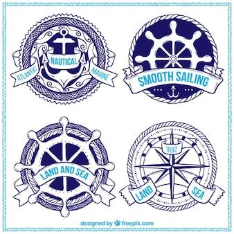 Disegnati a mano badge nautiche impostati