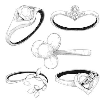 Disegnato a mano un set di diversi anelli di gioielli.