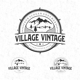 Disegno del logo vintage del villaggio