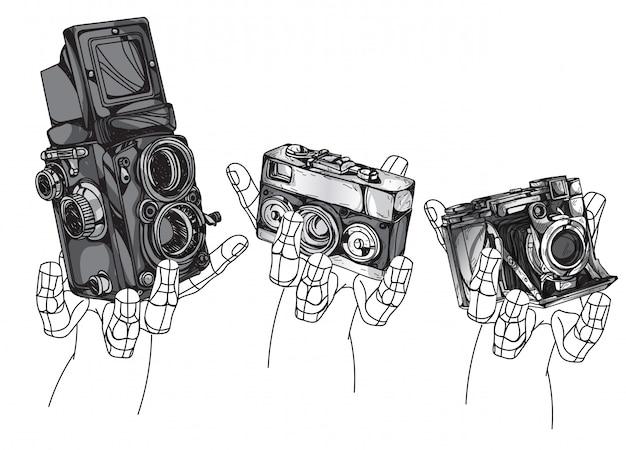 Disegno della mano della macchina fotografica dell'annata isolato su priorità bassa bianca.