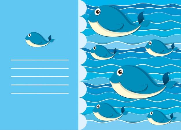 Disegno di carta con la balena in acqua