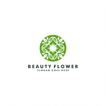 Disegno di marchio del fiore elegante astratto. logotipo di foglia verde natura