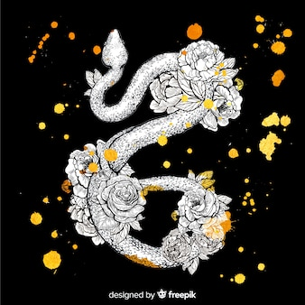Disegno floreale disegnato a mano sulla pelle di serpente