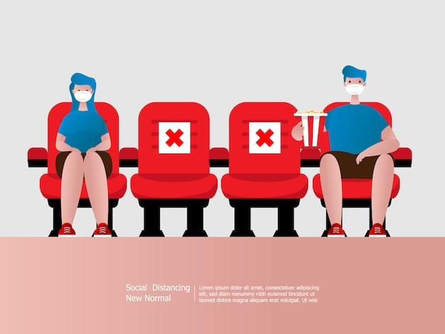Distanziamento sociale, ragazzo e ragazza che indossa la maschera nel cinema, concetto di diffusione dell'epidemia di virus