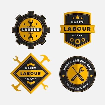 Distintivi di giorno internazionale di lavoratori design piatto