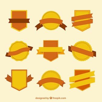 Distintivi giallo e arancio