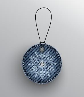 Distintivo in denim blu con fiocco di neve
