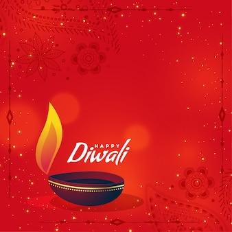 Diya creativo di diwali su fondo rosso con lo spazio del testo