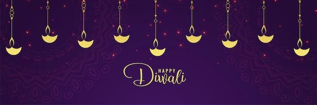 Diya dorato felice di diwali e fondo porpora