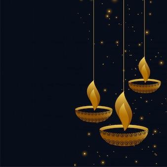 Diya sospeso di diwali su fondo scuro