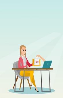 Donna caucasica che ottiene i sacchetti della spesa dal computer portatile.
