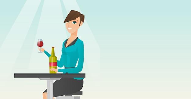 Donna che beve vino nel ristorante.