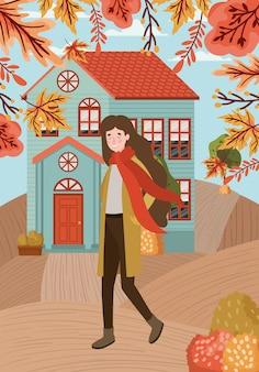 Donna che cammina con il vestito di autunno nella città