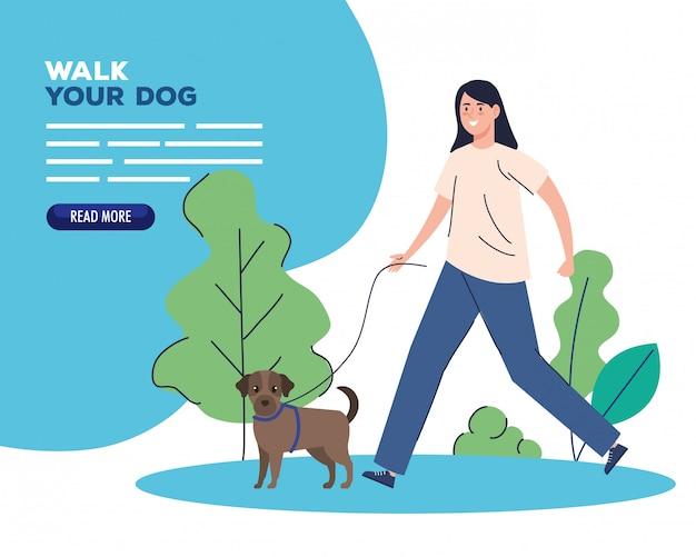 Donna che cammina il tuo cane nel parco