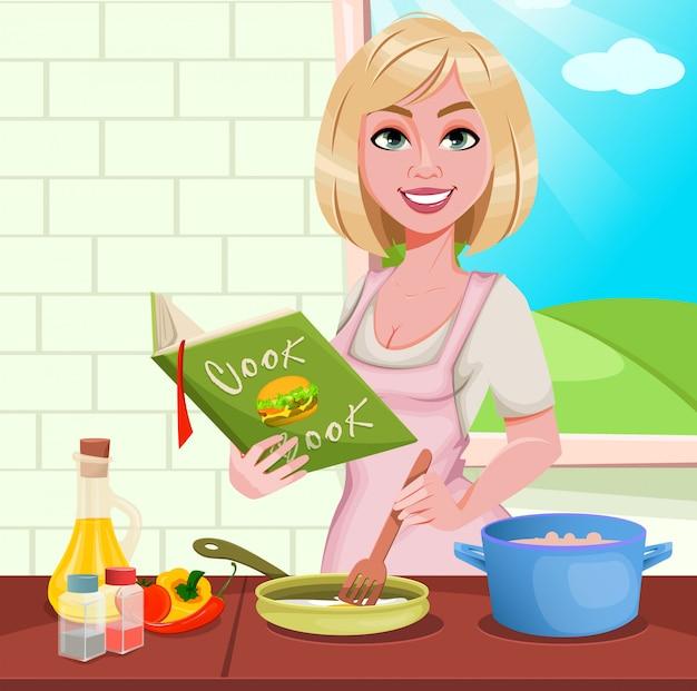 Donna che cucina a casa. ragazza allegra