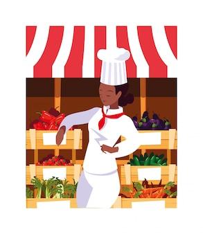 Donna che cucina, chef in uniforme bianca