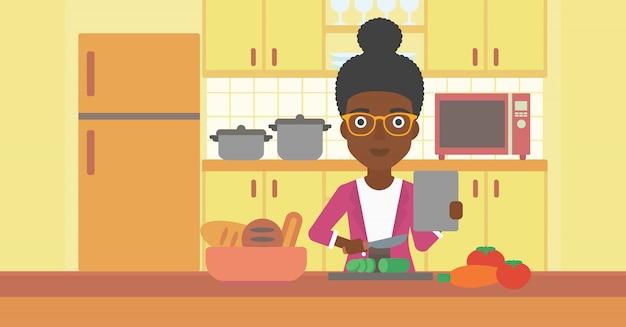 Donna che cucina pasto.