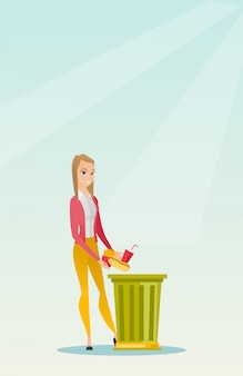 Donna che getta cibo spazzatura