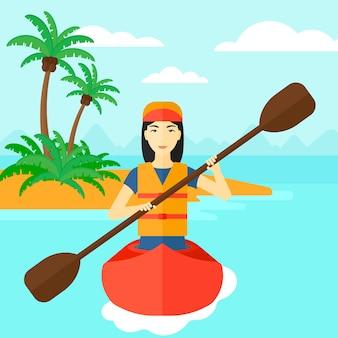 Donna che guida in canoa