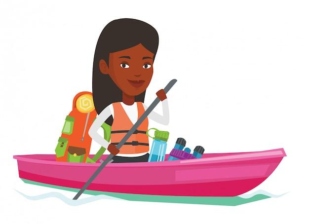 Donna che guida in kayak.