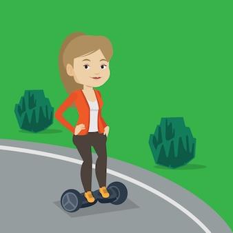 Donna che guida su scooter elettrico autobilanciante.