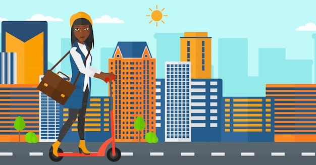 Donna che guida su scooter